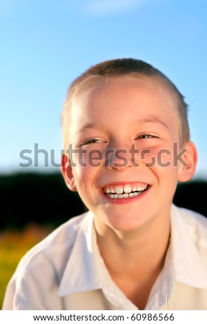 happy boy outdoor in the evening sunlight - stock photo