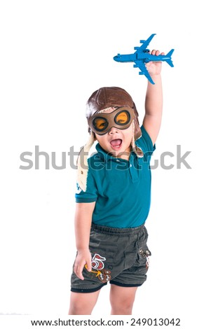 happy boy play in airplane indoors isolated on white  - stock photo