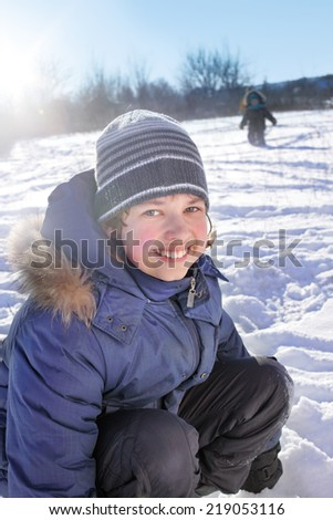 happy boy play outdoors in winter - stock photo