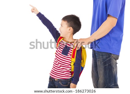 happy boy raise a hand to point   with father - stock photo