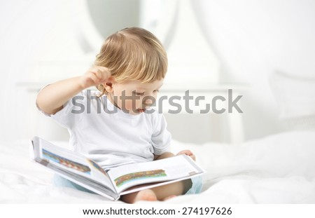 happy boy read book home - stock photo