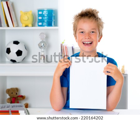 happy boy showing a white sheet - stock photo