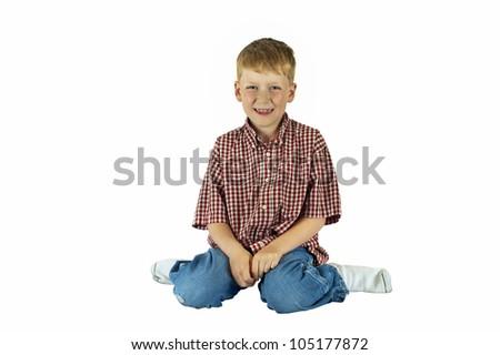 Happy boy sitting - stock photo