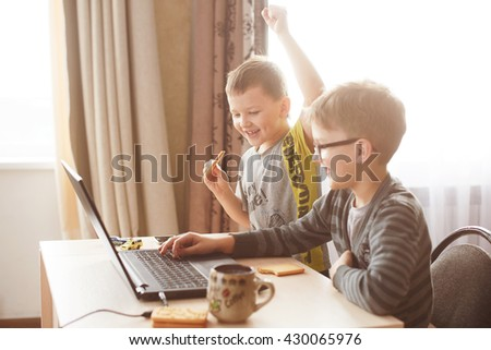 Happy boy sitting With laptop computer - stock photo