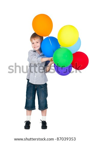 happy boy standing with balloons isolated on white background - stock photo