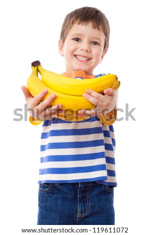 Happy boy stretches out ahead a bunch of bananas, isolated on white