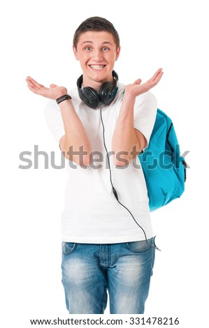Happy boy student with backpack and headphones, isolated on white background - stock photo