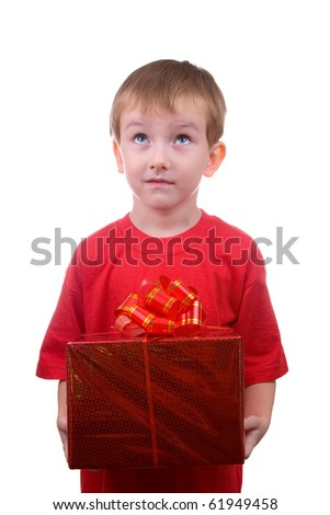 Happy boy thinks about the gift, isolated on a white background - stock photo