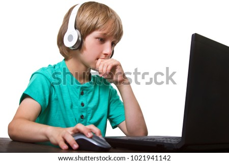 Happy Boy using a laptop against a white background