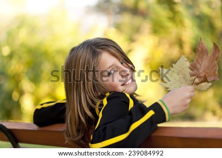 happy boy with autumn leaves - stock photo