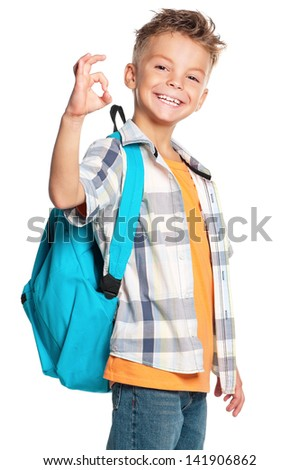 Happy boy with backpack showing ok sign, isolated on white background - stock photo