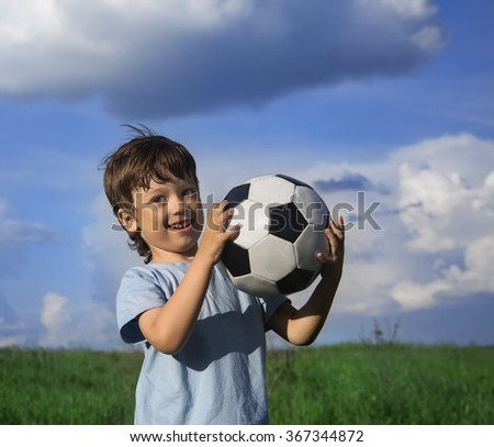 happy boy with ball outdoors - stock photo