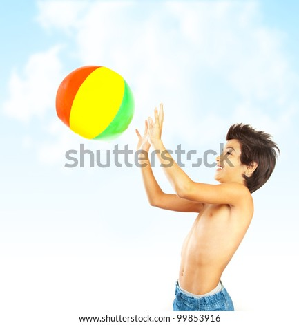 Happy boy with beach ball over blue sky, kid having fun outdoor, healthy child playing outside, cute teen enjoying sport and nature, summer holidays and vacation
