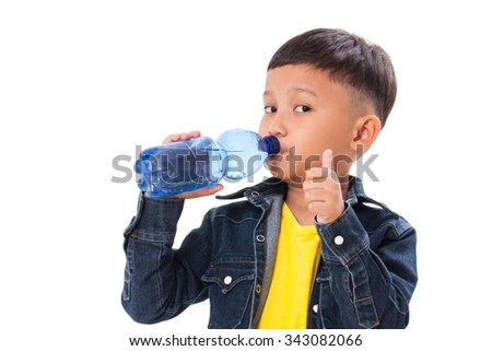 Happy boy with bottle of water and showing thumb up on white background - stock photo