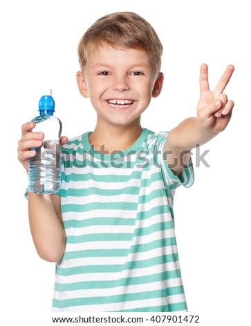 Happy boy with bottle of water isolated on white background - stock photo