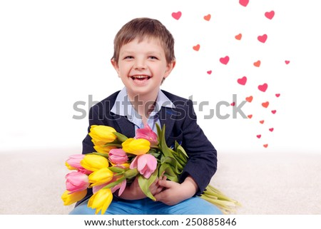 Happy boy with flowers. Yellow and pink tulips, March 8, Mother's Day, International Women's Day, Valentine's Day - stock photo