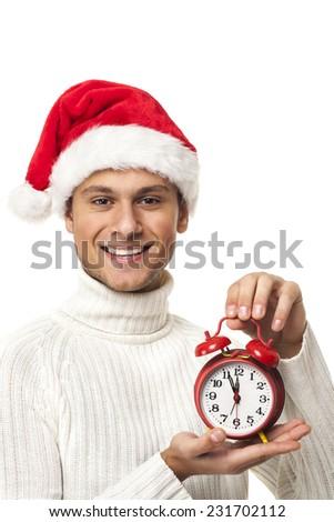 Happy boy with santa hat holding a clock - stock photo