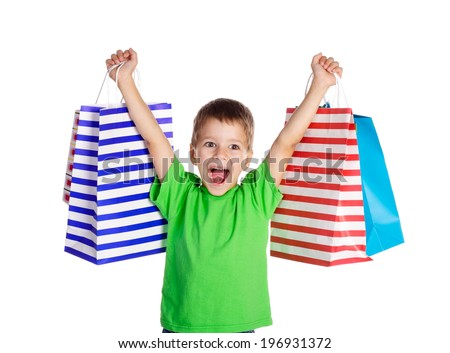 Happy boy with shopping bags, isolated on white - stock photo