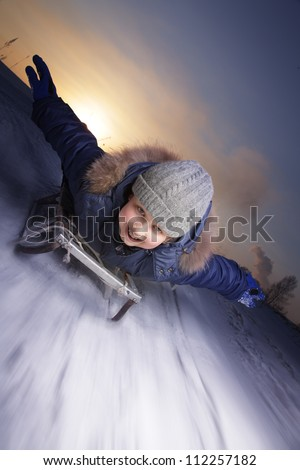 happy boys on sled - stock photo