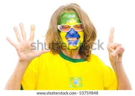 Happy Brazilian sport fan showing six fingers - stock photo