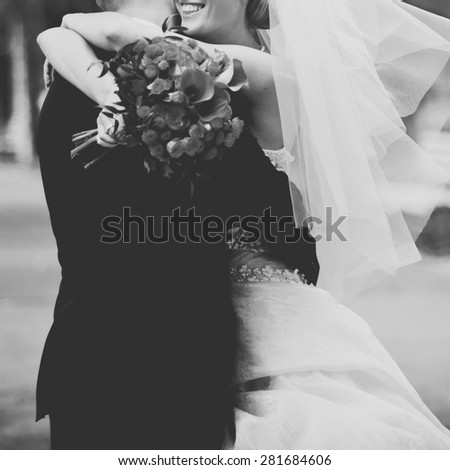 Happy bridal couple in garden. Summer wedding picture. - stock photo