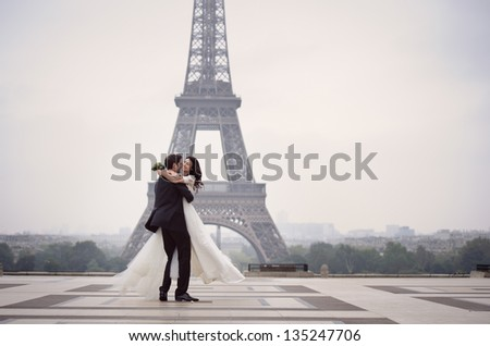 Happy bride and groom enjoying their wedding in Paris - stock photo
