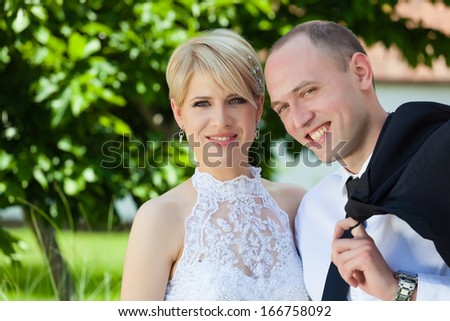Happy bride and groom have a fun in the park.Shallow doff