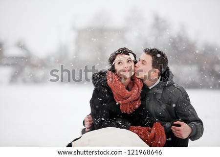 Happy bride and groom in winter day - stock photo