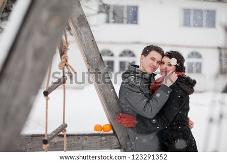 Happy bride and groom in winter day on their wedding - stock photo