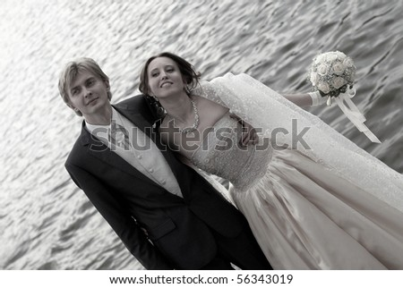 Happy bride and groom on the coast