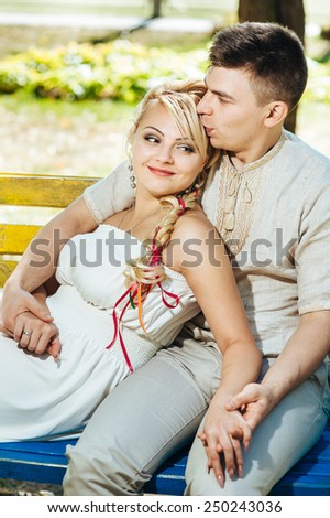 Happy bride and groom on their wedding. Groom and Bride in a park. wedding dress. Bridal wedding bouquet of flowers - stock photo