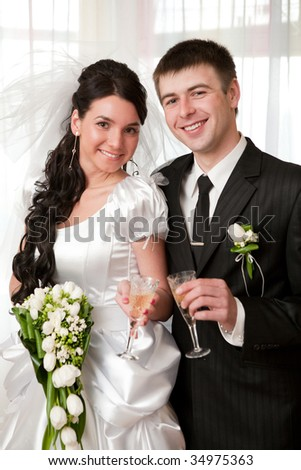happy bride and groom with champagne