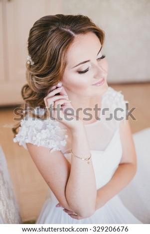 Happy bride having her wedding preparations - stock photo