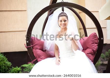 happy bride in the wedding dress - stock photo