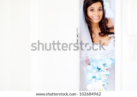 happy bride opening doors at doorway