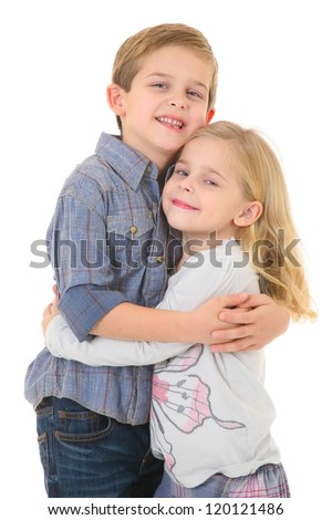 Happy Brother and Sister Hugging each other - stock photo