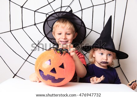 happy brother and sister on Halloween party