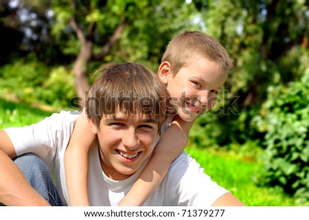 happy brothers in the summer park - stock photo