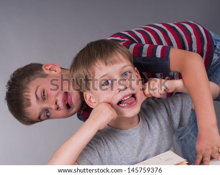 happy brothers making funny expressions - stock photo