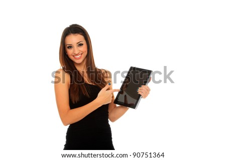 Happy brunette woman holding in hand a tablet touch pad computer and smiling on a white background - stock photo