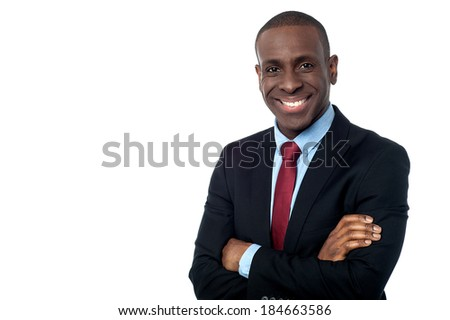 Happy business executive with arms folded - stock photo