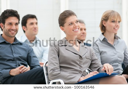Happy business group attending an educational meeting conference - stock photo