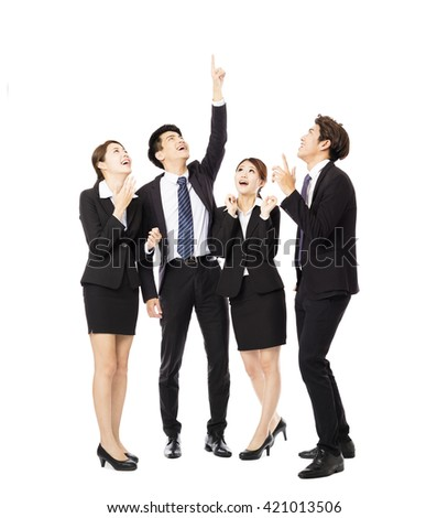 happy business group pointing and looking up  - stock photo
