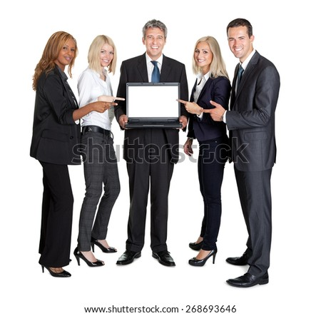 Happy business group pointing at the laptop screen on white background - stock photo