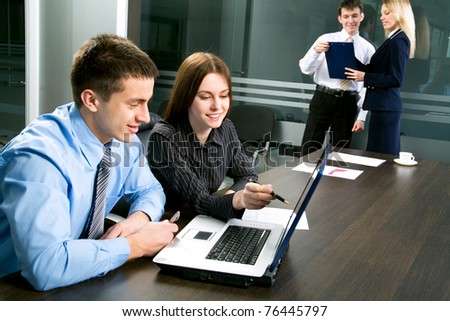 Happy business man and woman in a meeting - stock photo