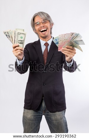Happy business man hold China , hongkong , united state of america, korea and japan money over a white background, asian model