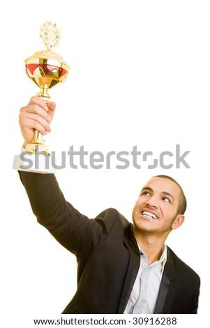 Happy business man holding a trophy aloft - stock photo