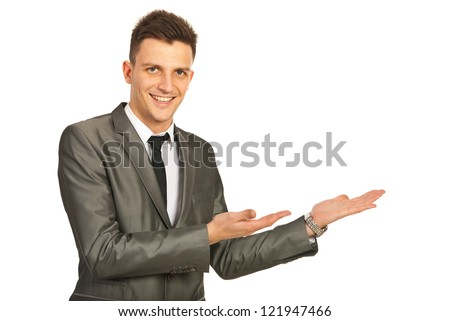 Happy business man making presentation with both hands to copy space isolated on white background - stock photo