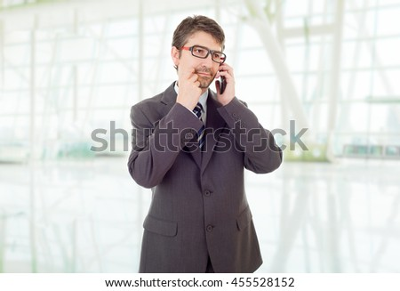 happy business man on the phone, at the office - stock photo