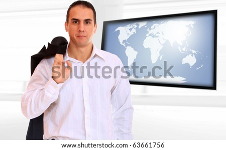 Happy business man presenting with world map on flat screen TV - Globalisation - stock photo